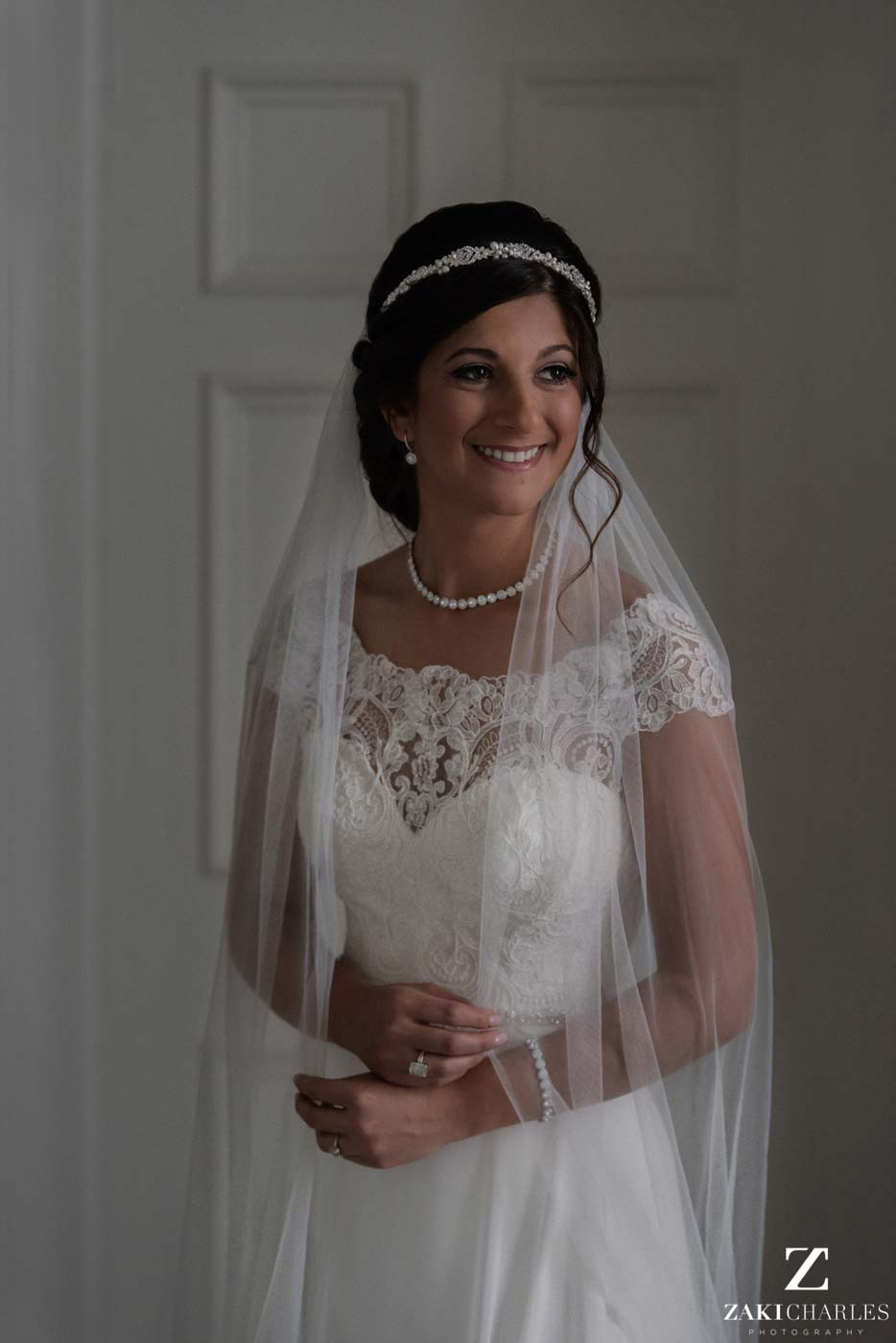 Natural light portrait of the bride smiling