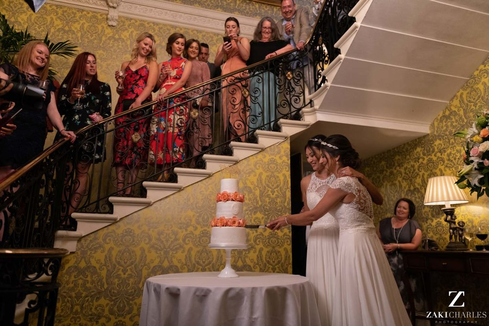 Cutting the wedding cake at Hedsor House