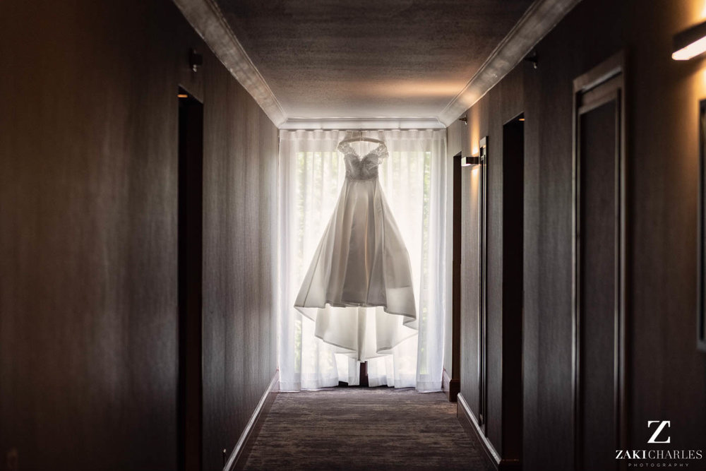 Dress of the bride hanging in Marriott Hotel Regents Park