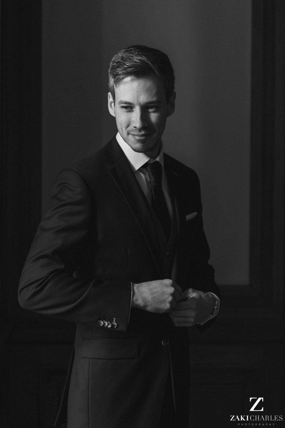 Natural light portrait of groom Josh black and white