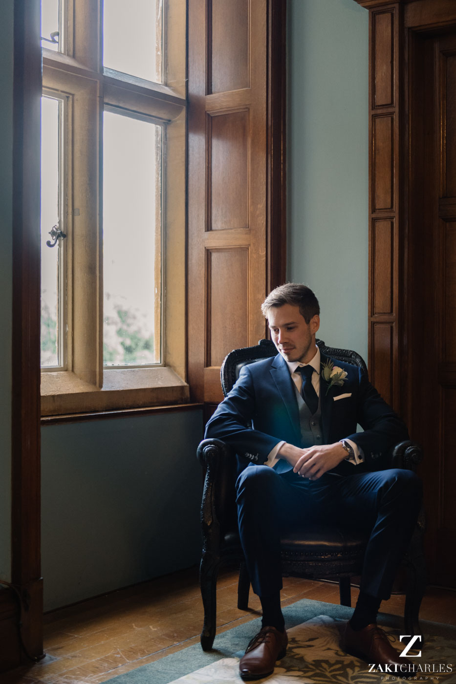 Natural light photography of the groom at Eynsham Hall