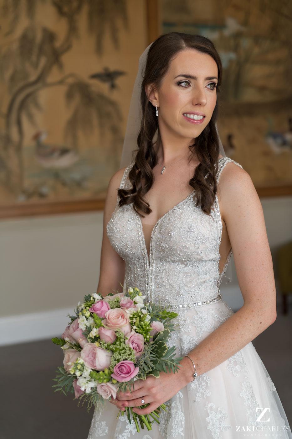 Natural light portrait of the bride at Eynsham Hall