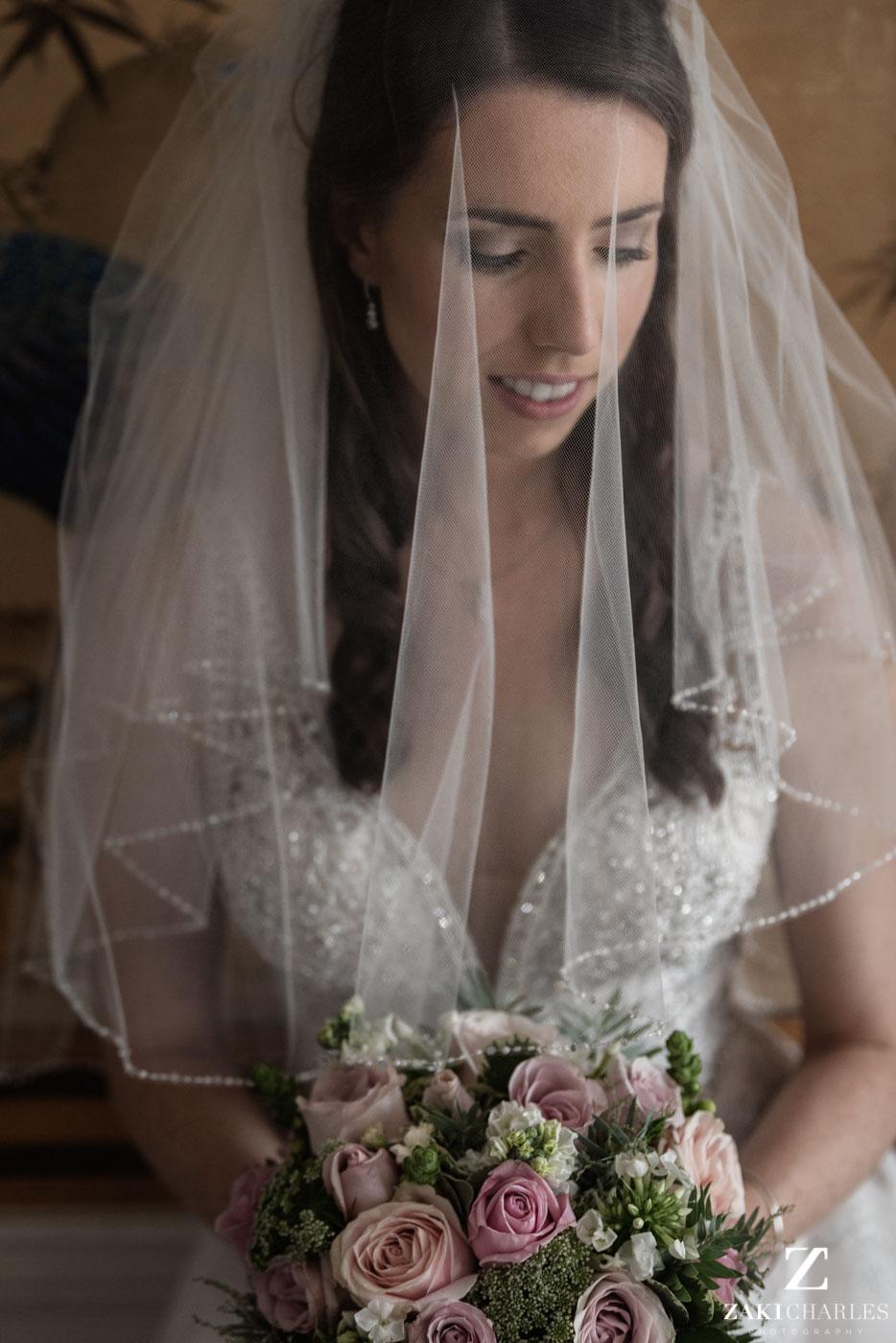 Natural light portrait of bride Caroline at Eynsham Hall 2
