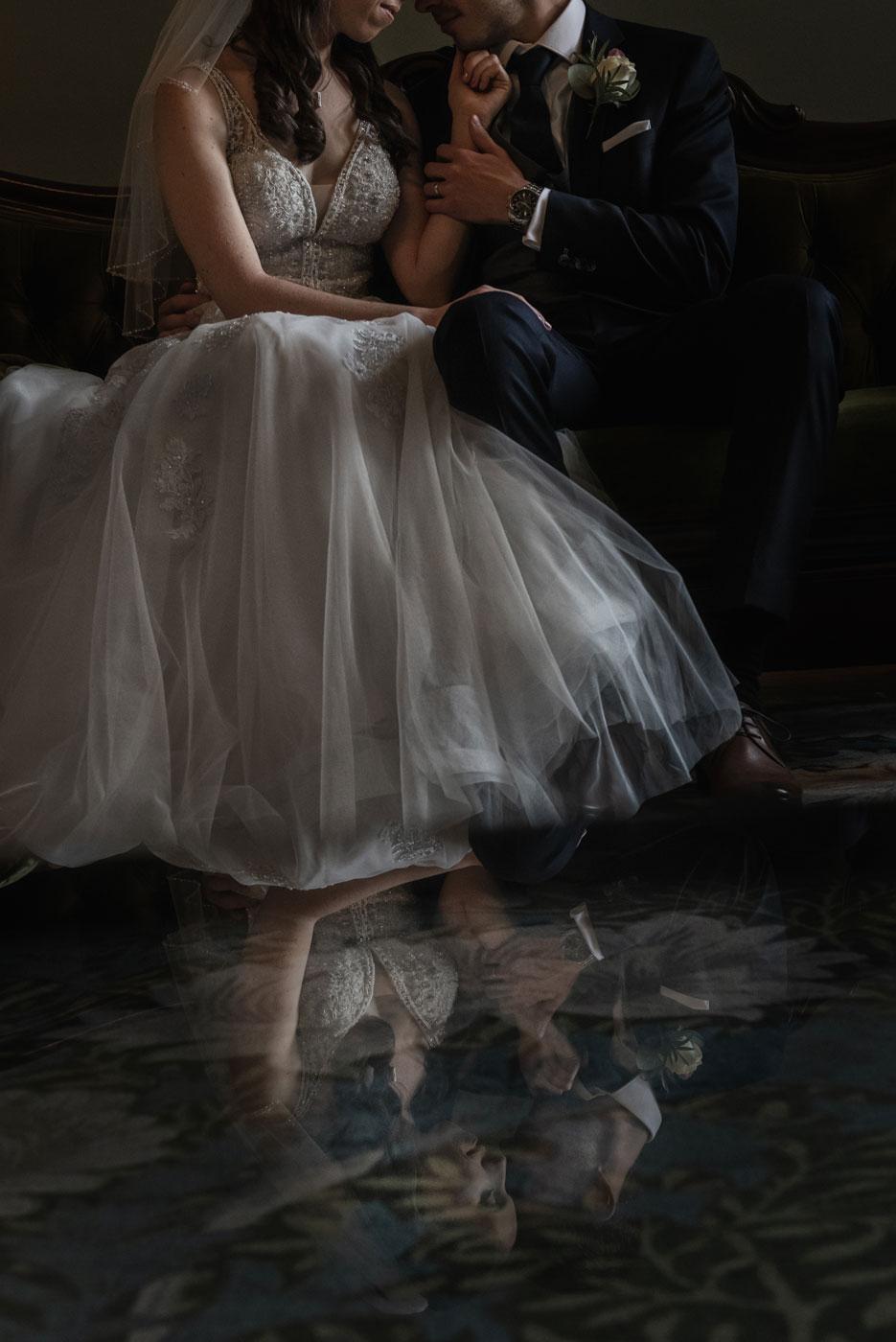 Reflection of bride and groom at Eynsham Hall