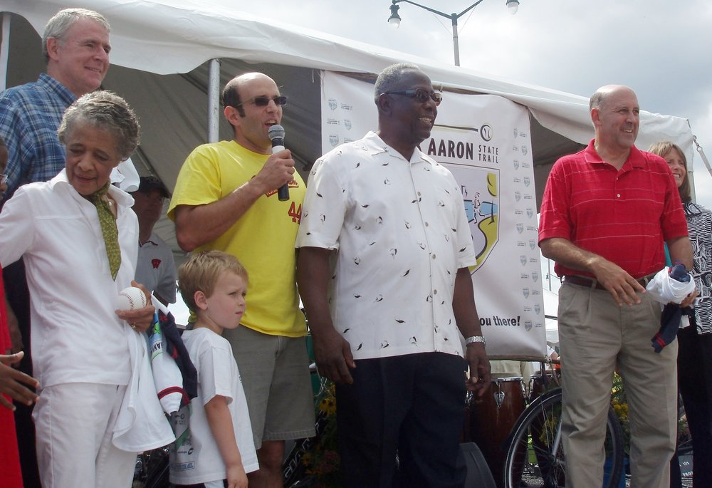 Photo: (left to right) Mayor Barrett, Vel Philips, Bruce Keyes, Hank Aaron, Governor Doyle  Milwaukee baseball legend Hank Aaron returned to Milwaukee for the  Hank Aaron State Trail Grand Slam  to officially open his namesake trail on August 12, 2006. Hank Aaron, Governor Jim Doyle, and Mayor Tom Barrett reminisced about Hank's early days in Milwaukee and noted how the Trail, like Hank Aaron himself, is breaking down barriers and uniting the Milwaukee community.