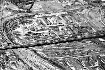 Overhead view of the Milwaukee Road Shops property with the 35th Street viaduct running across the middle of the image. The former chimneys are on the west side of the viaduct. All structures relating to the Milwaukee Road are now gone. (Milwaukee Road was the commonly used name for the Chicago, Milwaukee, St. Paul & Pacific Railroad.)