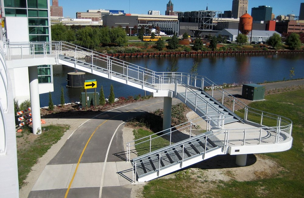 The Sixth Street ramp and stairs were recognized by the American Council of Engineering Companies for its innovative use of space, aesthetics, attention to safety and accessibility. There are stairs on the east side of the bridge - with a ramps to wheel your bike up and down - and a ramp on the west side of the bridge to connect to the trail below.