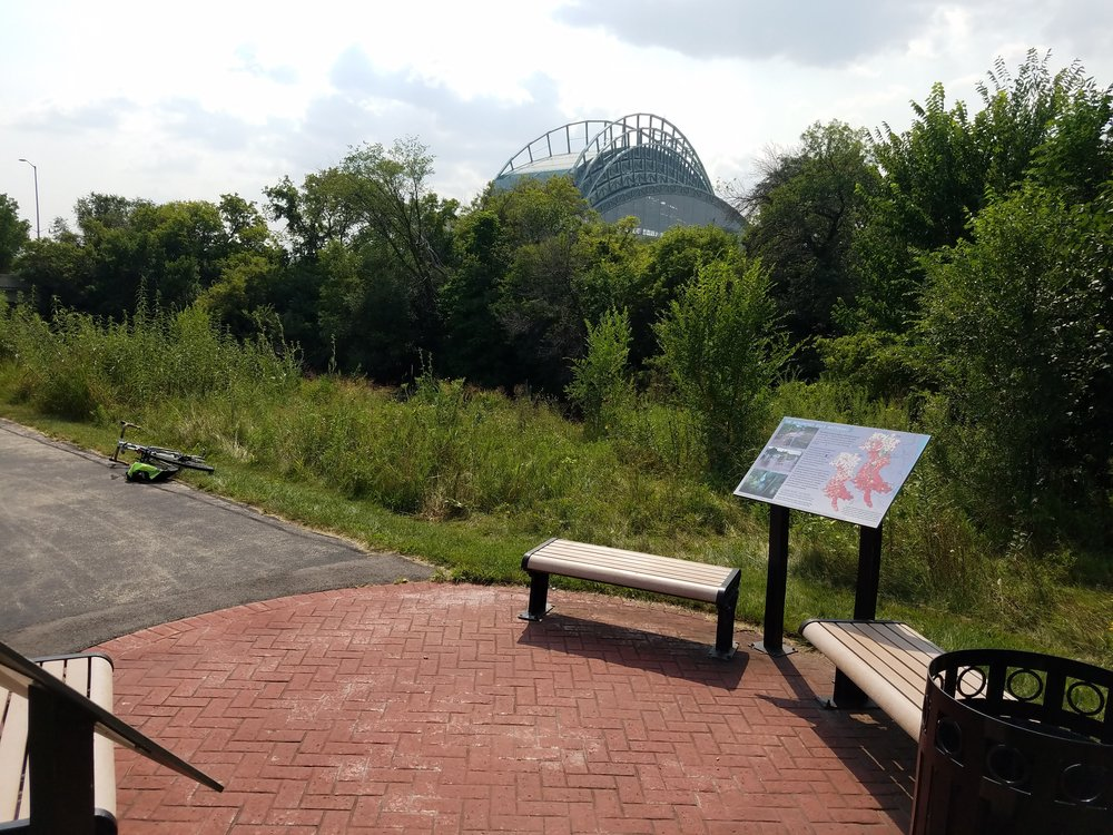 This sitting area is found along the Menomonee River near Miller Park.
