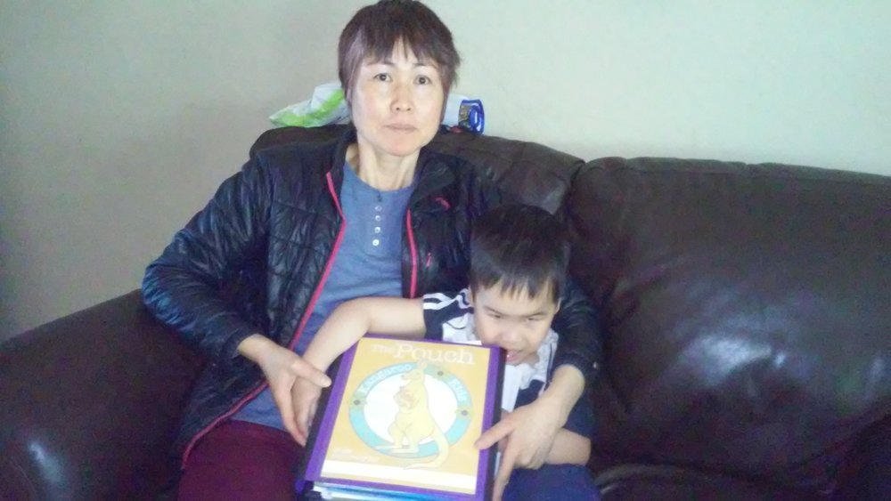 Baby and Mom with Pouch on Couch .jpg