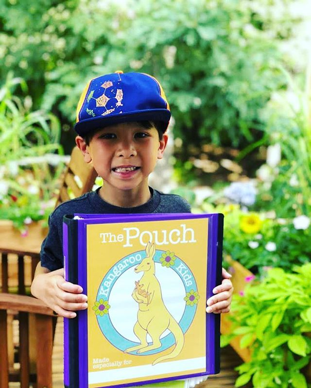"Check out this little cutie with his pouch!!! Isn't he adorable? We love receiving pictures like this from our ""little roo's""! 💜#KangarooKids #thepouch #helpingothers #sharecharlotte #levinechildrens #novanthealth"