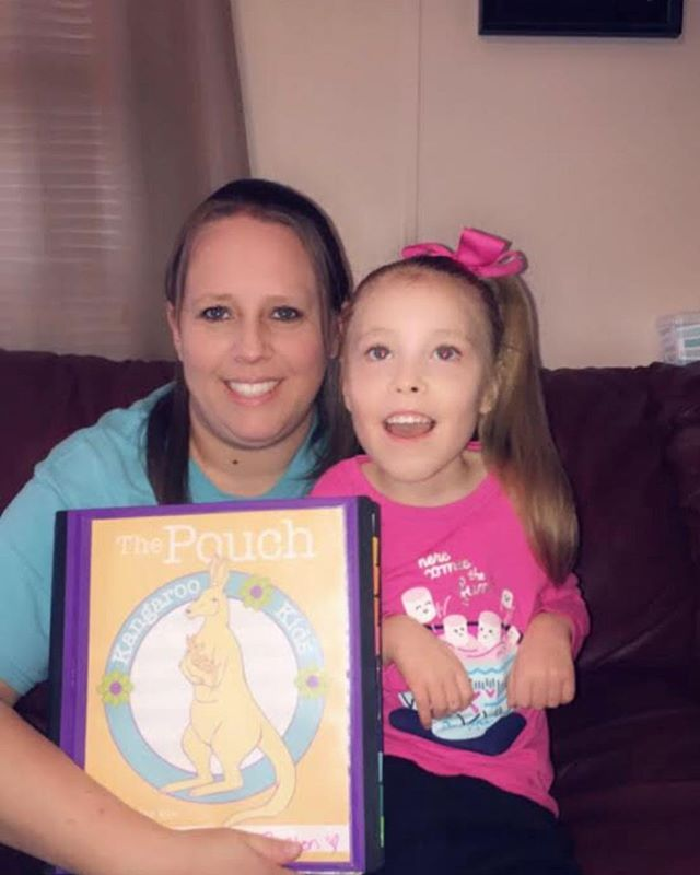 """My name is Brenda and this is my daughter McKenzie. I love The Pouch, it helps me keep track of and save all her therapists, IEP meetings and her appointments informations... it awesome! Thank you!!♡"""