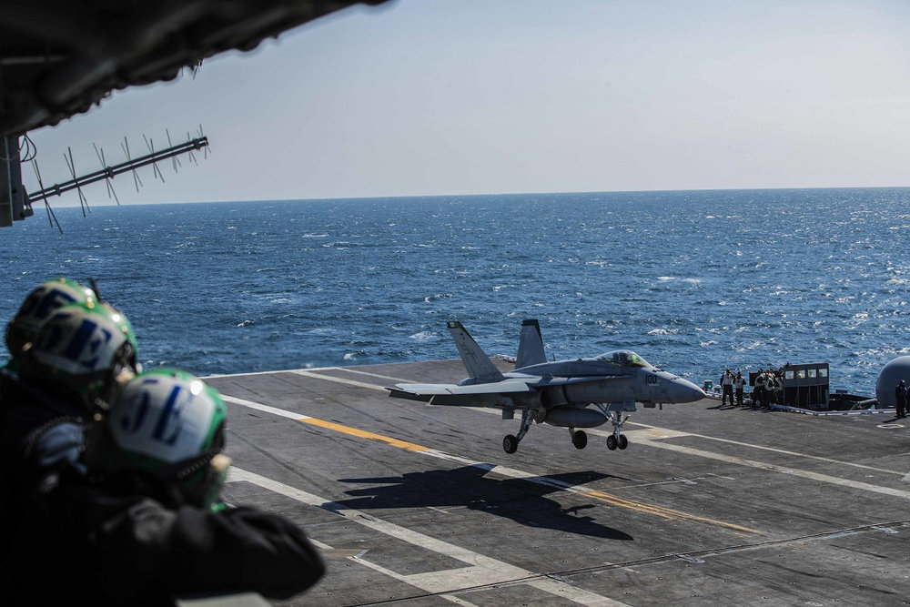 Photo Credit:Sailors observe an F/A-18E Super Hornet land during flight operations aboard the Nimitz-class aircraft carrier USS Abraham Lincoln on March 16, 2018. On Friday, lawmakers approved a massive $1.3 trillion budget deal that includes more money for new aircraft and other military priorities. (Mass Communication Specialist 3rd Class Tyler C. Priestley/Navy)
