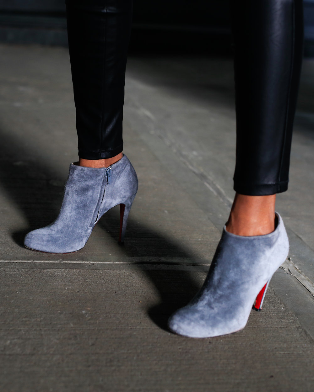 Close up shot of Kry's Christian Louboutin booties.