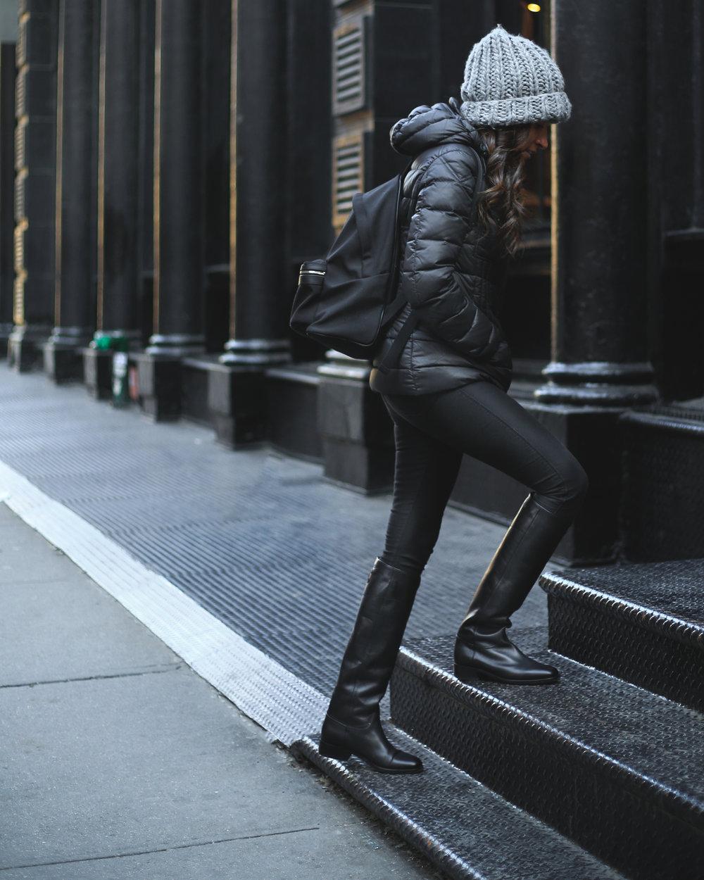 Krys wearing her black canvas Saint Laurent backpack.