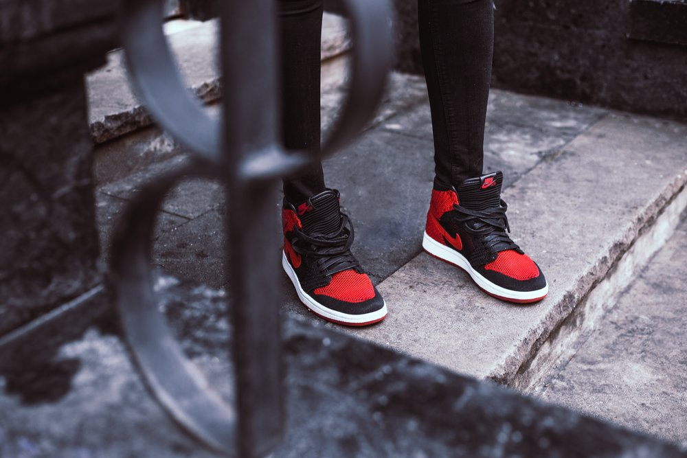 Close up shot of Black and Red Nike Air's.