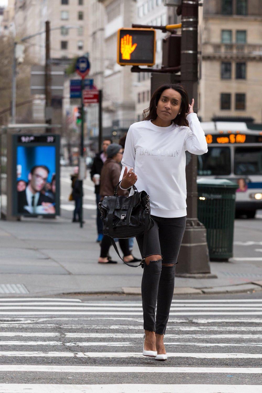 Krys modeling her sweatshirt style while crossing a street.