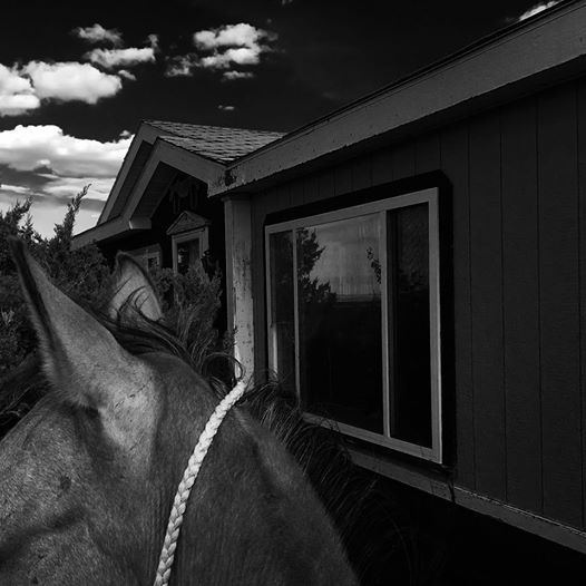 - Ever since I was little one of my favorite places to ride was up the road to visit my Grandpa. I would ride right up next to this window and wait until he would see me... he would always greet me with the biggest smile and a friendly wave. Oftentimes I would tie my horse up and go inside for a short visit. He was quick to offer me a cookie, tell me a story about a horse from his past or just offer me some daily encouragement. I never left his house without first getting a firm handshake and maybe a kiss on the cheek. And no matter what, he would always tell me how much he loved me, and that he was proud of me. It's hard to believe that it has been almost two years since we have enjoyed a visit together, Grandpa. Tonight as I rode next to your window, I could imagine your cheerful smile through that glass... I would give an awful lot to once again firmly grip your big hand and tell you I love you. I know without a doubt that you loved me, because you never missed an opportunity to tell me. That is just one of the many things that I learned from you... and I am forever grateful. I miss you lots, Grandpa... and as you would always say...