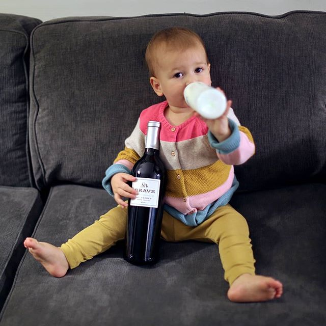Apparently someone wasn't satisfied with just one bottle -- Lucie stole my 2015 @MtBraveWines Merlot, a gorgeous wine produced exclusively from #MtVeeder fruit. Fortunately, I was able to wrestle it from her (I let her keep the other) to taste it for myself -- and it's jam-packed with plum, blueberry, and chocolate (or is it vanilla? Both, really...) notes with a rich, full body and complex finish. I'd first encountered winemaker Chris Carpenter's work a couple of years ago at a tasting for @CardinaleWinery -- one of the other esteemed #NapaValley wineries to which he lends his talents. And if there's one thing he does well, it's make wines that last. This one, like Lucie -- is still just a baby right now; I'd love to see what it's like in five, or even ten years. . #MtBrave #ChrisCarpenter #NapaWine #NapaWines #NapaValley #NapaValleyWine #NapaValleyWines #WineBaby #CuteBaby #CuteBabyGirls #NapaMerlot #MerlotDay #MerlotMonth #CaliforniaMerlot #MerlotWine #Merlot🍷