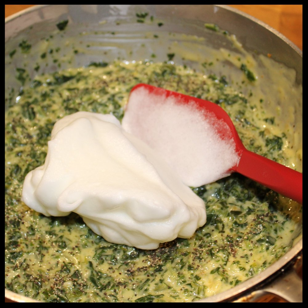 14. Take about 1/4 of the whites and add to the spinach mixture.  15. GENTLY stir them in - this loosens the mixture so that adding the remaining whites is easier.