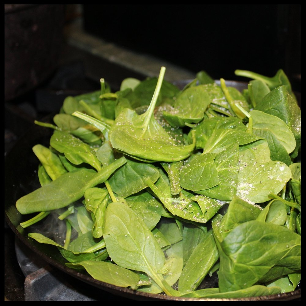 2. Heat up your saute pan on medium-high and add the spinach. Season lightly with salt and pepper.  3. Cook until just wilted (less than a minute). Remove pan from heat and take spinach out.   4. Wipe the pan clean with a paper towel.