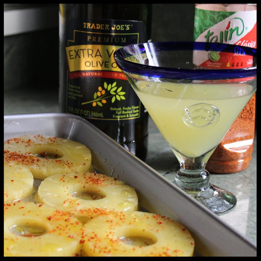 8. Lay the pineapple slices on a sheet pan.  9. Drizzle with olive oil, and if you have some  Tajin  (a mexican seasoning salt) sprinkle with that. If you don't, sprinkle a little chili powder and a touch of salt on top.   10. RESERVE THE PINEAPPLE JUICE!