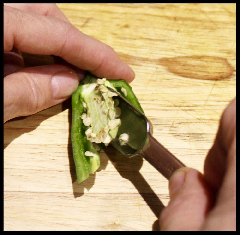 DR JJ TIP : Use the end of a spoon or a smallish measuring spoon to dig under the seeds and core of a hot pepper. You literally can scoop out the entire core in a swipe or two and spare yourself burning fingertips.