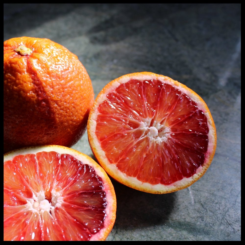 INSTRUCTIONS:   1.  Cut 2 of the blood oranges into quarters, remove any visible seeds. (if using regular oranges, just quarter one)  PS - aren't they gorgeous! In Los Angeles, my neighbor's tree produces so much fruit, that they share withe the entire block. I typically will juice tons of them, and freeze the juice in ice cube trays. I also zest a ton of them and freeze it in ziplocks. Both come in handy for smoothies, cakes, cocktails, and just drinking some fancy OJ!