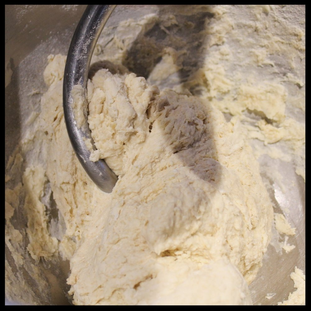 3. Beat with your dough hook or your personal best mojo and a wooden spoon for about 30 seconds (until the dough comes together and there is no visible dry flour.