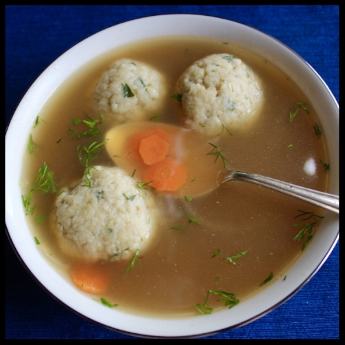 "KIDDOC JJ'S CHICKEN SOUP (with a twist) and JOANNE'S MATZOH BALLS   (Thanks to Ina Garten for inspiration!)  A traditional matzoh ball soup starts with a clear, flavorful chicken stock. Depending on your crowd, allow at least 1 1/2 cups - 2 cups of soup per person with either 1 large or smaller matzoh balls. Make sure you have extra! If you need a great chicken stock recipe (that is made in a crockpot),  click here . You can make it weeks ahead and freeze it until the day before your Seder. I've twisted my typical plain chicken soup with a few Asian ingredients, as my buddy Joanne's Matzoh Balls are laced with ginger and ground almonds. This is a fresh, springy twist on an ageless favorite.  (If you prefer a ""classic"" version, just use salt and pepper and a handful of fresh chopped parsley, dill, and tarragon in your soup, and brighten your broth with a couple of squeezes of lemon juice. I would keep the matzoh balls the same, except use all chopped parsley).     JOANNE'S MATZOH BALLS  (makes 18, enough for 6 people)    KIDDOCJJ Tip :  This recipe can easily be adapted to Gluten Free by using Gluten Free Matzoh, and grinding them in your food processor.   WHAT YOU'LL NEED:  - large bowl, whisk - pot of boiling salted water (I add a chicken bouillon cube for extra flavor)  I NGREDIENTS:  - 4 large eggs - 3 TB schmaltz (I just took the chicken fat off that rose to the top of my stock - easy peasy!) or veggie oil - 1 cup Matzoh Meal (if you can't find it, grind up a few plain matzoh in your food processor) - 1/2 cup chicken stock - 1/4 cup finely ground almonds (if you are nut allergic or don't like almonds, skip this) - 1 tsp fine sea salt or Morton's kosher salt. If using Diamond Kosher salt, use 1.5 tsp - 2 TB finely chopped parsley, and 1 TB chopped cilantro (eliminate this for ""classic recipe) - 3/4 tsp ground ginger (eliminate this for ""classic"" recipe)   INSTRUCTIONS:  1. Crack the eggs into a medium bowl, ad the schmaltz or oil and whisk until smooth. 2. Add the matzoh meal, chicken stock, almonds, salt and chopped herbs and mix well. 3. Refrigerate, uncovered 45-60 minutes. 4. Put your water and bouillon on to boil and with wet hands, roll the matzoh mixture into 18 balls. 5. Place them all at once into the boiling water, wait until they rise to the top. Turn the flame down to simmer, cover (NO PEEKING), and cook for 20 minutes.    KIDDOCJJ Tip:   I use a heatproof glass plate to cover matzoh balls, rice, and anything else I need to monitor visually. It makes it so much easier to follow the progress!  6. If serving immediately, add 3 matzoh balls to each bowl of hot soup. Sprinkle with more chopped herbs.  If preparing way ahead,  you can freeze the matzoh balls. Just wrap them tightly in saran, and heavy duty foil. To cook, just add the frozen balls to your hot chicken soup, turn to low, cover, and defrost/reheat in the flavorful stock.  If cooking 1-2 days ahead,  add the balls to your soup, cover, and keep in the fridge. Then heat up on low, covered, for about an hour before serving.   KIDDOCJJ CHICKEN SOUP  (feeds 6)    KIDDOCJJ Tip:    This soup is amazing without matzoh balls, especially on cold days or when you are under the weather. You can add rice or rice noodles (or even ramen) to the broth for a satisfying Asian soup.    INGREDIENTS:  - 3 quarts chicken stock - 2 carrots, sliced thin into coins - 1/2 small brown onion, sliced thin - 1/4 cup rice vinegar* - 2 TB soy sauce* - 1 tsp chili paste (Sambal Oleek is what I used)* - 1/2 tsp sesame oil* - salt and pepper to taste - chopped parsley and cilantro* or if going ""classic"", parsley, dill and tarragon   INSTRUCTIONS:  1. Heat up the stock to boiling, then turn to low/simmer. 2. Add the carrots and onions, and cook until al dente. 3. *If opting for the Asian flair - add the soy sauce, rice vinegar, chili paste, and sesame oil. Stir and adjust seasoning with salt, pepper, and more rice vinegar if you prefer a brighter taste. Put the matzoh balls into the broth to reheat now. Right before serving throw in some chopped cilantro and parsley, and 3 matzoh balls/bowl. 4. If going ""classic"", just season the soup with salt and pepper and brighten the flavor with some freshly squeezed lemon. Reheat the matzoh balls in the broth. Right before serving, add some freshly chopped parsley, dill and tarragon and serve immediately."