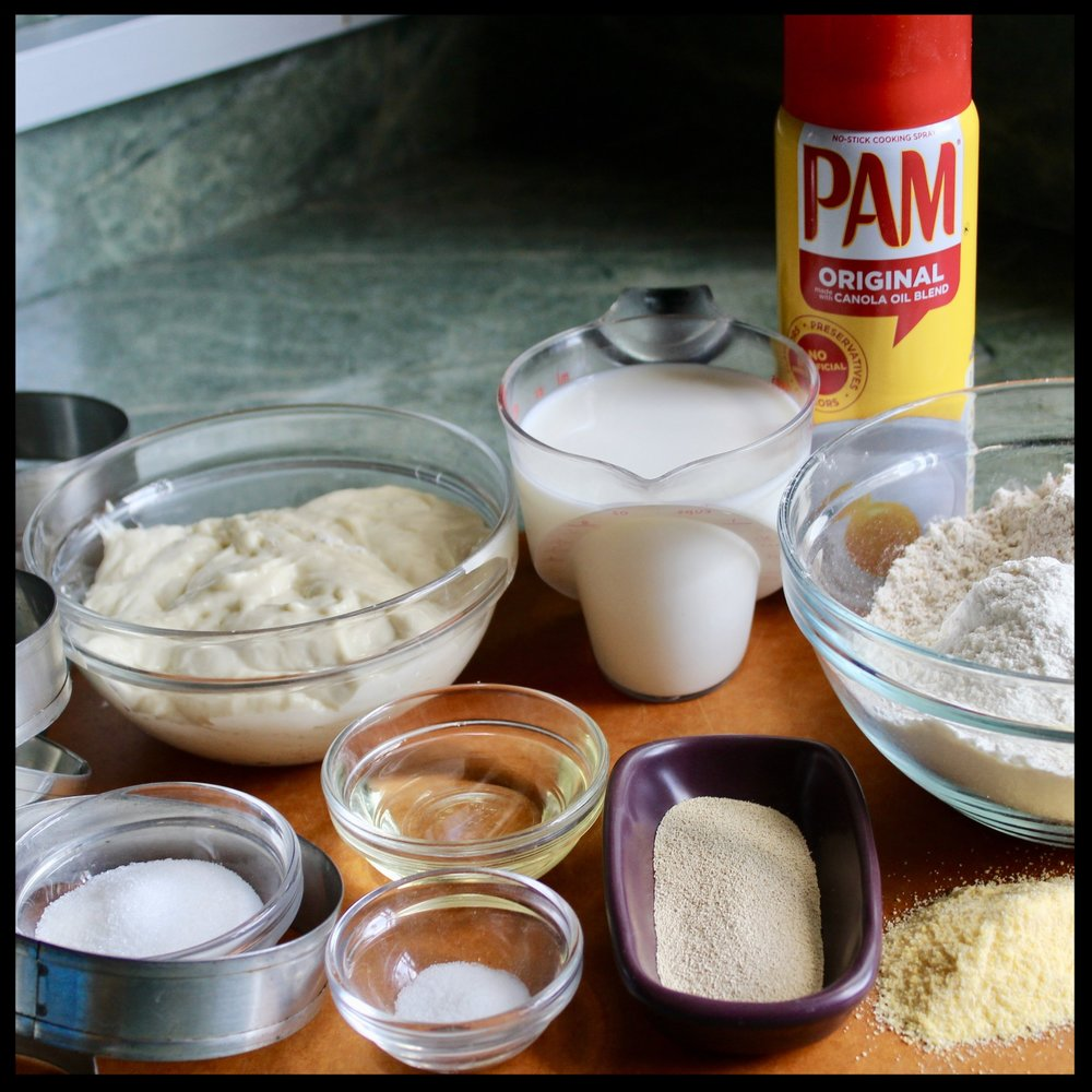 WHAT YOU NEED:   - griddle  - stand mixer with paddle  - English muffin rings **see note   INGREDIENTS:   - 2 cups flour (I used 1 1/4 cup all purpose and 3/4 cup whole wheat)  - 2 TB sugar  - 1 TB yeast  - 3/4 tsp sea salt  - 1 cup sourdough starter or  biga  at room temp  - 9 ounces whole milk, warm  - 1 1/2 TB canola or vegetable oil  - cornmeal for sprinkling; vegetable oil spray