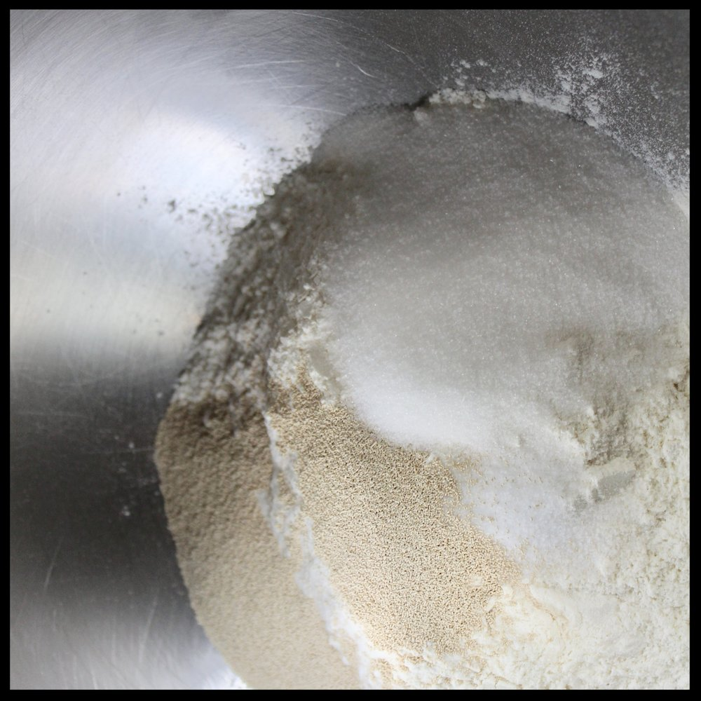 INSTRUCTIONS:   1.  Put the paddle attachment on to your stand mixer.   Into its bowl, put the flour(s), salt, yeast and sugar.  2.  Briefly mix the ingredients with mixer on low speed.