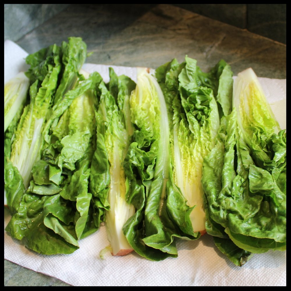 WHAT YOU NEED   -  a grill and tongs  -  sharp knife   INGREDIENTS    -  1 large head of romaine - quartered, washed and drained on paper towels  -  extra virgin olive oil