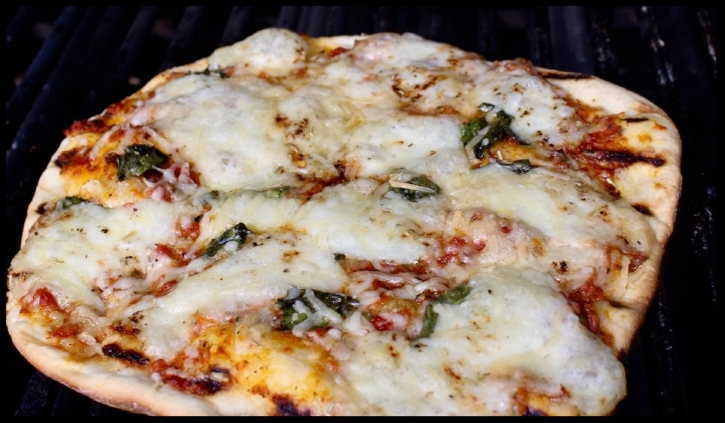 Classic MARGHERITA Pizza - tomato, basil, cheese. Simple. Delicious.