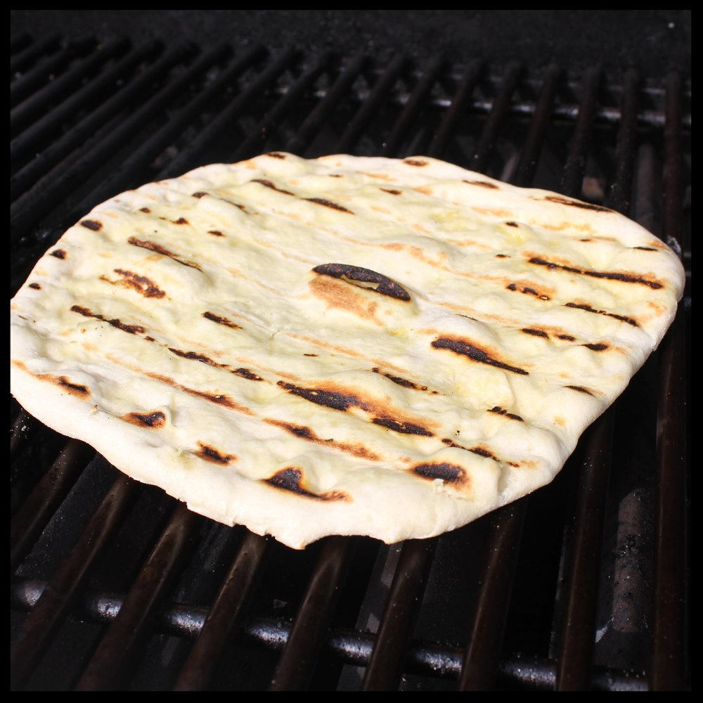 12. Put the crust(s) on the flameless part of the grill, oiled side down. Close the lid and let cook for 5 minutes.  13. Flip the crust over. Now it's time for toppings.