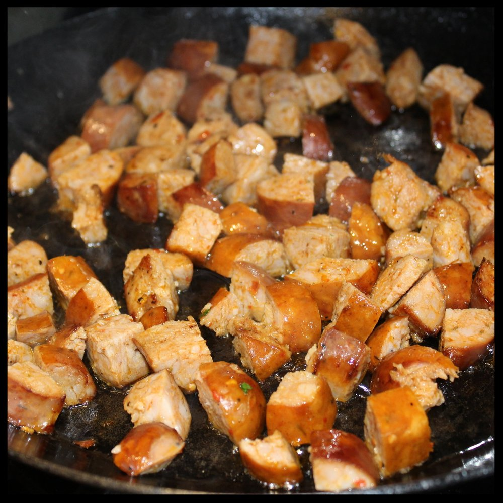 3.  Cut the sausages in half length-wise and then chop into half moons.  4. Saute in a hot pan until browned on the edges, and some fat has been released into the pan.  5.  Transfer the sausage to your a large bowl and leave about a TB of the fat in the pan.