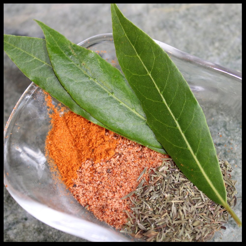 8.  Sprinkle with the cayenne, cajun seasoning, and thyme, and drop in the bay leaves.  Stir briefly until fragrant.