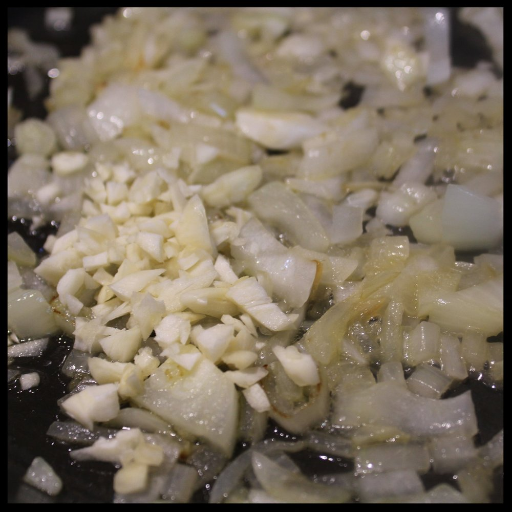 INSTRUCTIONS   1.  Heat a frying pan over medium, add 1-2 TB olive oil, and saute the onions until translucent.  2.  Add the garlic and saute for another minute or 2 until fragrant.