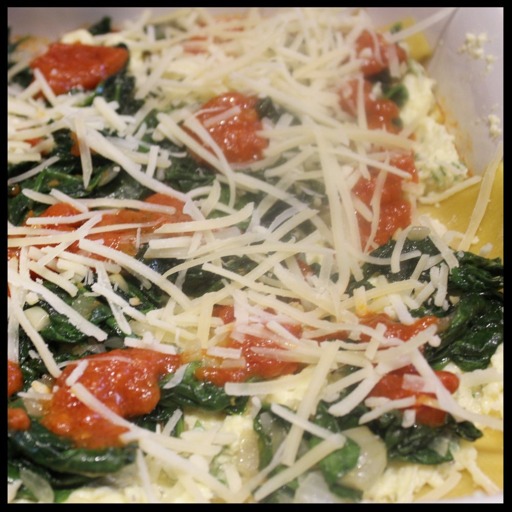 12.  Sprinkle this with some added parmesan.  13.  Build another layer:  noodles, cheese mixture, spinach, tomato sauce and parmesan.