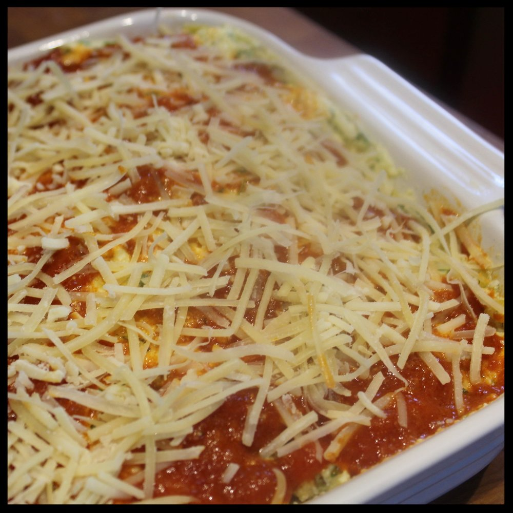 14.  The last layer is noodles, ricotta mix, tomato sauce and a generous amount of grated parmesan.  Into the oven at goes, uncovered, for 40 minutes (on 350).  If your pan is pretty full, place the baking pan on a larger sheet to catch any possible spills.