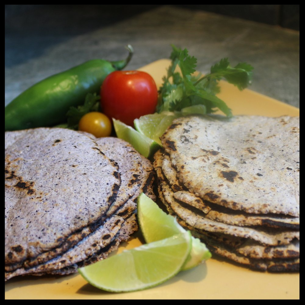13.  While you are cooking each tortilla you can be pressing another one, so you'll pick up a bit of a rhythm.  Of course you'll want to taste one right off the griddle. Spritz with lime, a little butter or salsa. Ole!