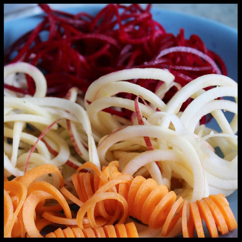 LARGE BLADE:  This works brilliantly for raw slaws and salads. It's especially great when you use apples - no peeling or coring necessary. Spiralize apples by cutting off the ends just so they are flat. Center the core on the hub of the spiralizer. As you process the apples, you'll see that the seeds and core just drop out. Try spiralized apples in your pancake or muffin batter!