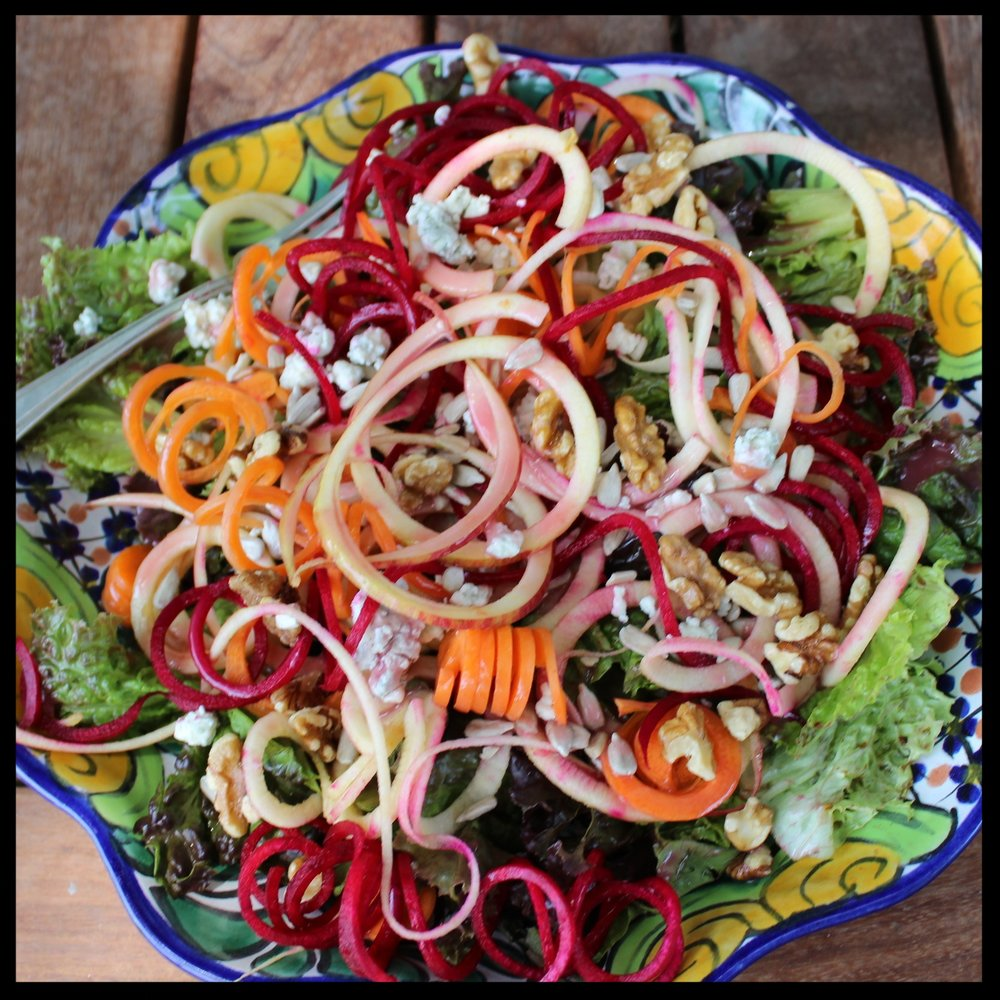 For an easy salad, use the large blade to cut a red beet, a carrot and an apple. Scatter onto some leaf lettuce - sprinkle on blue cheese, walnuts, sunflower seeds and some prepared raspberry dressing. Delicious and so easy - AND you get a big jump on your 5 servings of produce a day!