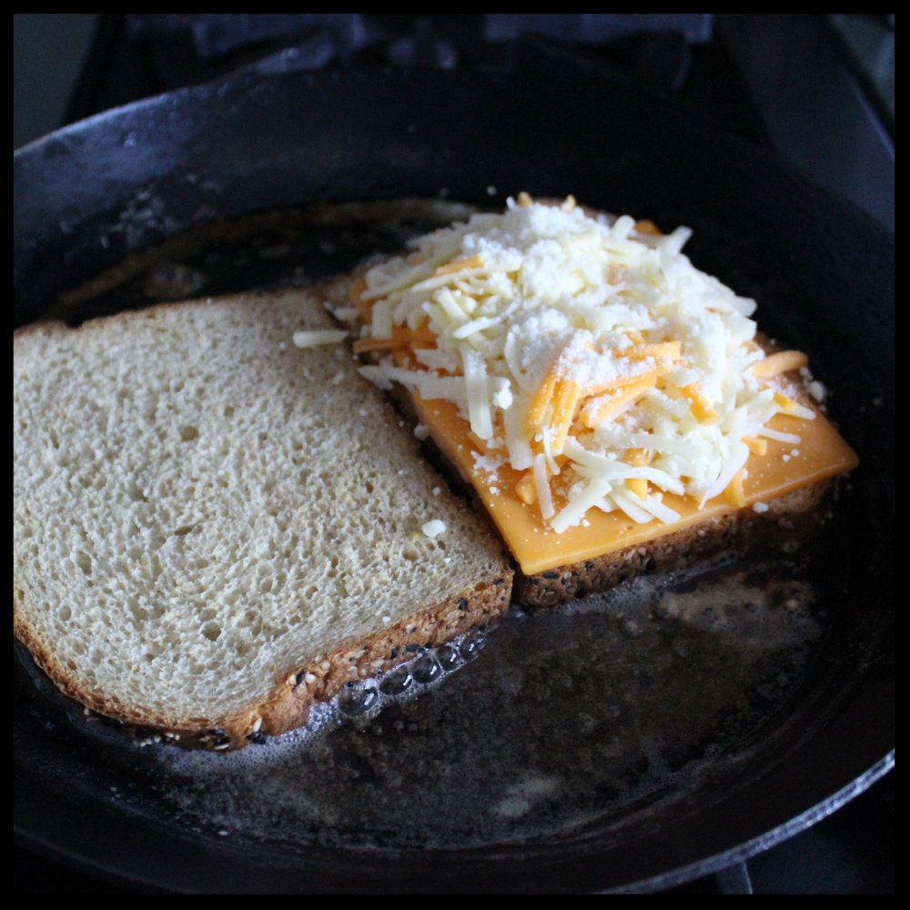 INSTRUCTIONS:   1. Melt butter in a cast iron or non-stick pan over medium heat.  2. Once butter is nutty brown, lay down the bread and then layer the cheese on one side.  3. Rotate the bread around the pan to absorb all that butter flavor and when it is light golden brown, close up the sandwich.