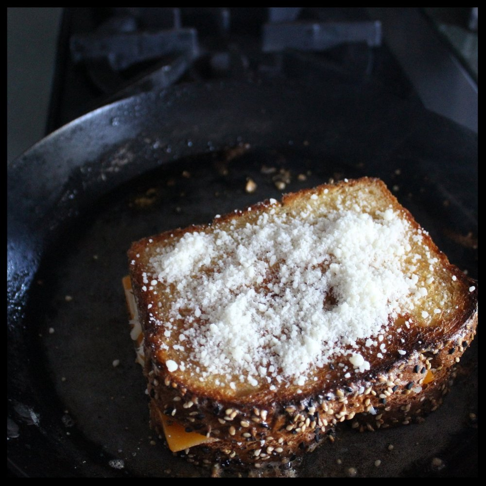 4. Lightly sprinkle some grated cheese on the top side, press in with your spatula, and flip over for 2 minutes. Repeat on the other side.