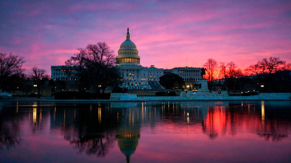 In this Feb. 6, 2018 photo, dawn breaks over the Capitol in Washington. A simmering diplomatic crisis tearing at the Middle East is unfolding in Washington's corridors of power as bitter rivals Qatar and the United Arab Emirates trade accusations and battle for influence with Congress and the Trump administration. Both countries spent heavily over the last year on lawyers, lobbyists, and public relations specialists as each seeks better trade and security relationships with the U.S., according to disclosure records filed with the Justice Department.  J. Scott Applewhite  - AP Photo
