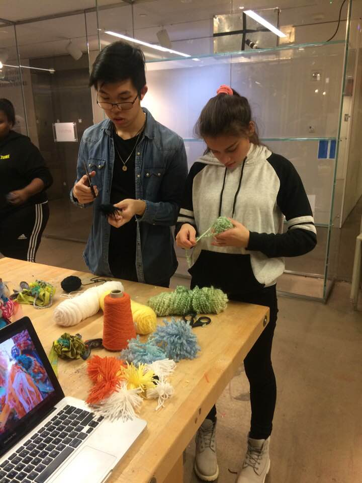 Making some pom-poms together!