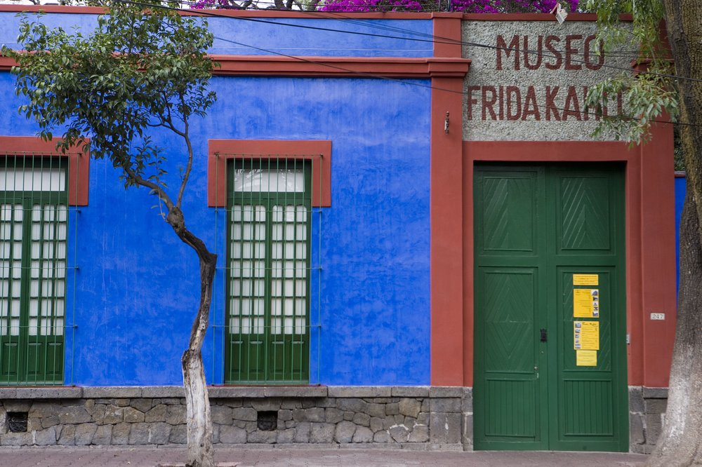 Museo Frida Kahlo - Oct 31 After the Witch Market, we'll head to the Museo Frida Kahlo for an afternoon of connection with this beloved ancestor and her historical objects. This museum, in her former home Casa Azul,holds some of Frida's paintings and many of her personal effects. A popular exhibit onsite features her dresses and clothing.