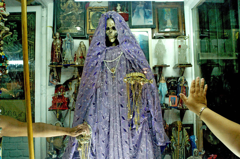 Santuario de la Santa Muerte - Nov 1 On Dia de los Inocentes, our group will visit Tepito, where there is a significant open-air shrine to Santa Muerte. We will bring candles and offerings to give to the Skeleton Saint, and spend some time at her altar before heading to the Zocalo, where there will be lunch, Aztec dance, offerings of copal smoke, and Dia de los Muertos activities.