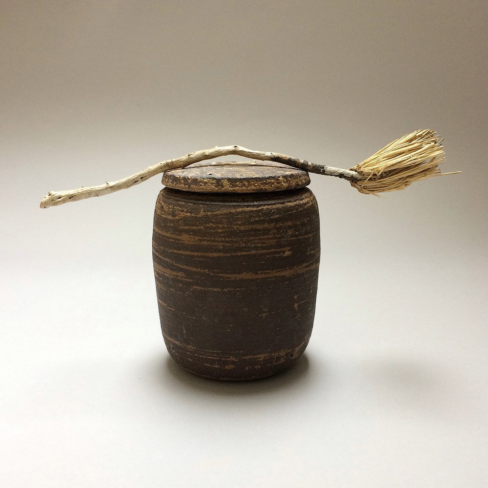 pot with brush