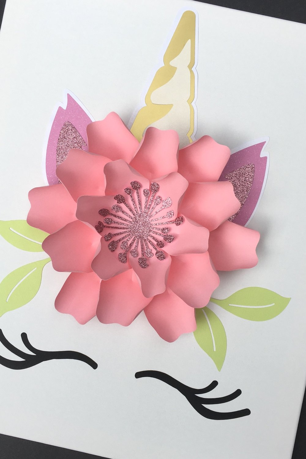 """Unicorn Kit ($12) - What's included?- 1 ready made 9"""" paper flower (choice of color)- 1 set of ears (pink or purple)- 1 horn- 1 set of eyelashes- 1 set of leaves***** .Does not include 16"""" x 20"""" canvas *****How To Buy: Send us an inquiry"""
